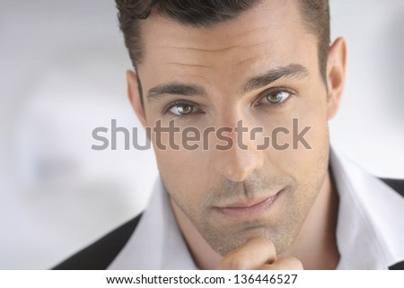 Closeup portrait of a young attractive man thinking - stock photo