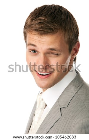 Closeup portrait of a young attractive man winking - stock photo
