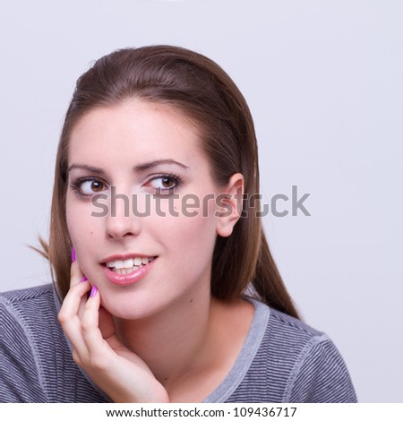 closeup portrait of a young beautiful girl thinking - expression - stock photo