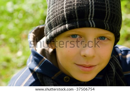 closeup portrait of a young boy in a cap - stock photo