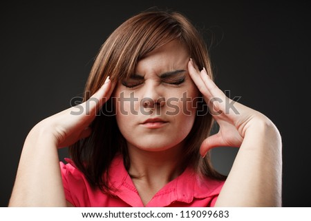 Closeup portrait of a young businesswoman with a strong migraine - stock photo