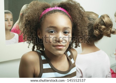 Closeup portrait of a young girl in bathroom with friends - stock photo
