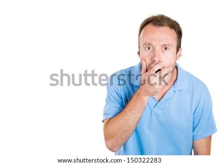 Closeup portrait of a young handsome guy surprised, shocked, scared, with hand covering mouth, isolated on white background with copy space - stock photo