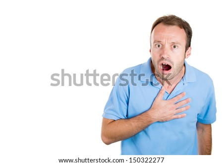 Closeup portrait of a young handsome guy surprised, shocked, scared, with hand on chest, isolated on white background with copy space - stock photo