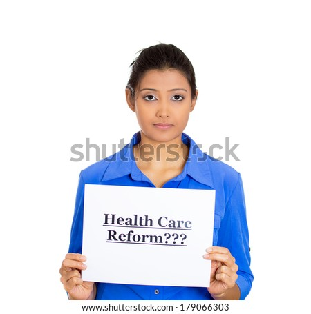 Closeup portrait of a young serious woman holding a sign health care reform, uncertain of universal insurance coverage, isolated on a white background. politics, government , legislation - stock photo