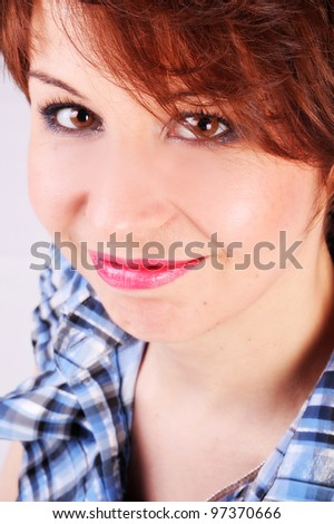 Closeup portrait of a young smiling beautiful woman in blue - stock photo