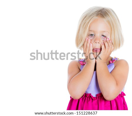 Closeup portrait of adorable, but sad and stressed girl pulling eyes down with fingers, isolated on white background with copy space to left - stock photo
