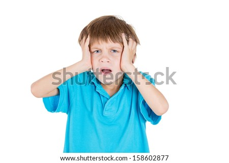 Closeup portrait of adorable kid stressed with headache, hands on head, isolated on white background - stock photo