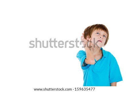 Closeup portrait of adorable kid with hands on ear trying to listen in on a conversation isolated on white background with copy space - stock photo