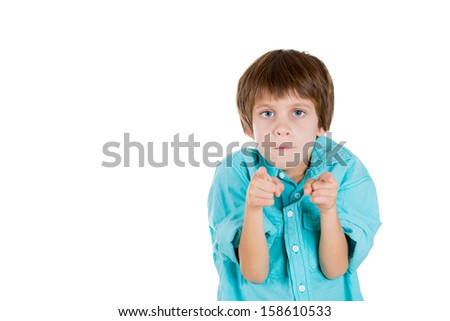 Closeup portrait of adorable serious kid pointing at you or camera gesture, isolated on white background with copy space - stock photo