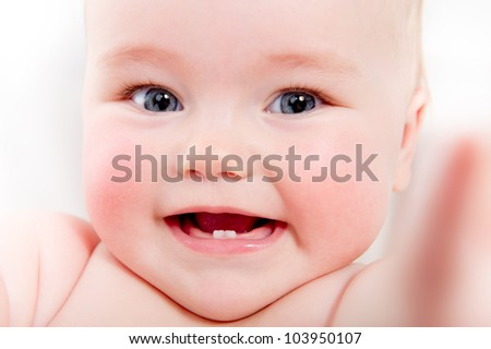Closeup portrait of adorable smiling baby girl - stock photo