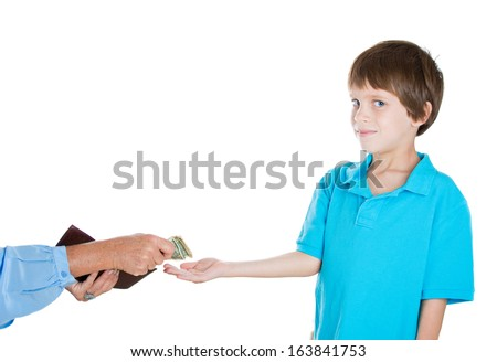 Closeup portrait of adorable smiling little boy in blue shirt demanding money for allowance, woman pulls out money from wallet to give him, isolated on white background - stock photo
