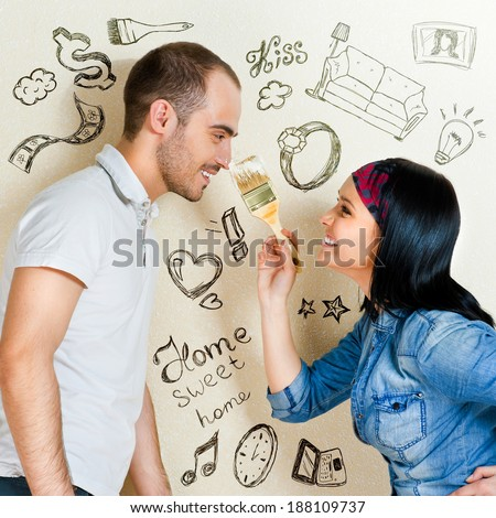 Closeup portrait of adult couple at their apartment renovating of their new apartment  - stock photo