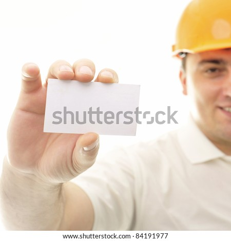 Closeup portrait of adult engineer man holding blank business card - stock photo