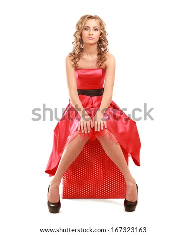 Closeup portrait of an attractive young woman sitting , isolated on white background - stock photo