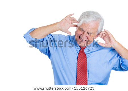 Closeup portrait of an elderly executive, boss, man covering his ears looking down, as if to say, stop making that loud noise it's giving me a headache, isolated on white background with copy space - stock photo