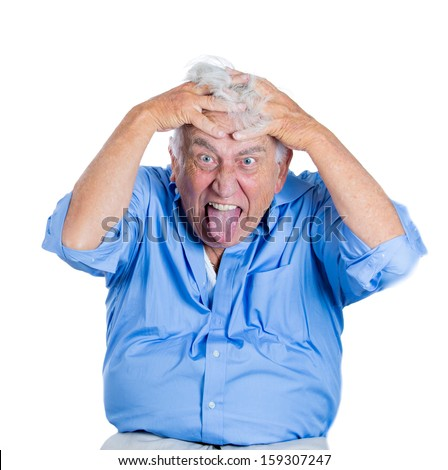 Closeup portrait of an elderly, mad, looking crazy, desperate, old man, going insane, laughing, loosing his mind, sticking out his tongue, pulling out hair, isolated on a white background. Emotions - stock photo