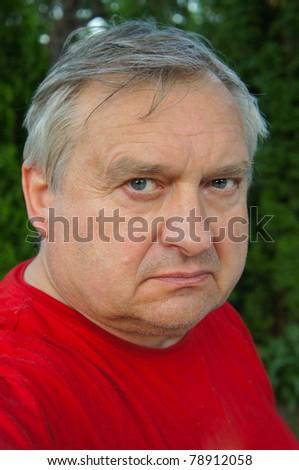 Closeup portrait of an elderly man outdoor - stock photo