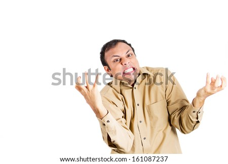 Closeup portrait of angry, frustrated man, about to have a fit, arms shaking in air, isolated on white background with copy space. Negative human emotions and facial expressions - stock photo