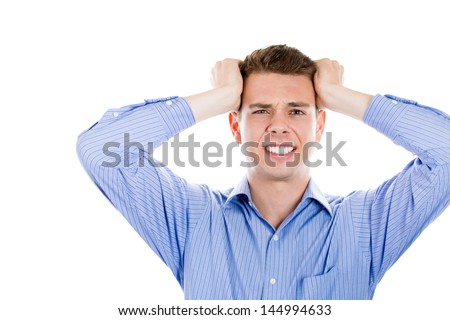 Closeup portrait of angry, frustrated man, pulling his hair out, isolated on white background with copy space - stock photo