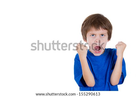 Closeup portrait of angry kid raising two fists in the air and yelling with mouth wide open, isolated on white background with copy space - stock photo