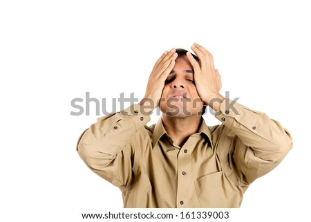Closeup portrait of angry, mad, furious man, worker, employee, businessman in brown shirt with hands on head, isolated on white background with copy space. Negative human emotion facial expressions - stock photo