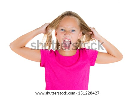 Closeup portrait of angry, stressed out girl pulling hair out, isolated on white background - stock photo