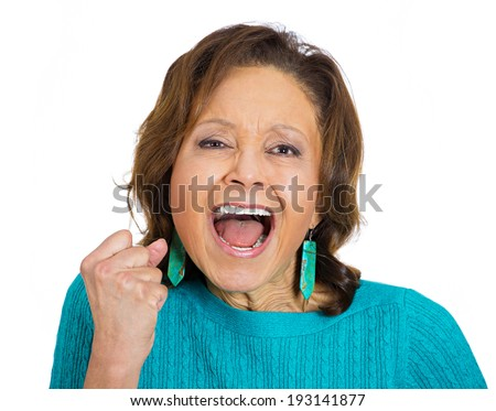 Closeup portrait of angry, upset senior mature woman worker, employee, business woman fist in air, open mouth yelling isolated on white background. Negative emotions, facial expression reaction  - stock photo