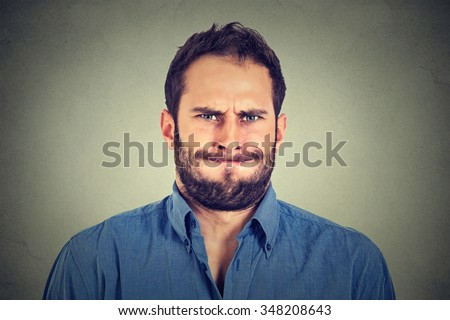 Closeup portrait of angry young man about to have nervous breakdown isolated on gray wall background. Negative human emotions facial expression feelings attitude reaction  - stock photo