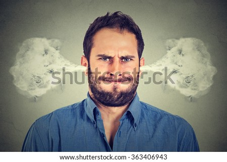 Closeup portrait of angry young man, blowing steam coming out of ears, about to have nervous atomic breakdown isolated gray background. Negative human emotions facial expression feelings attitude - stock photo