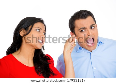 Closeup portrait of angry young woman pulling ear lobe of surprised shocked in pain hurting funny man, isolated on white background. Negative emotion facial expression feelings, reaction, situation. - stock photo
