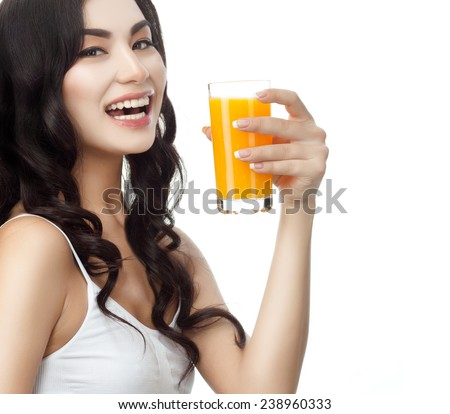 closeup portrait of attractive asian smiling woman brunette isolated on white studio shot lips toothy smile face hair head and shoulders looking at camera tooth drinking orange juice - stock photo