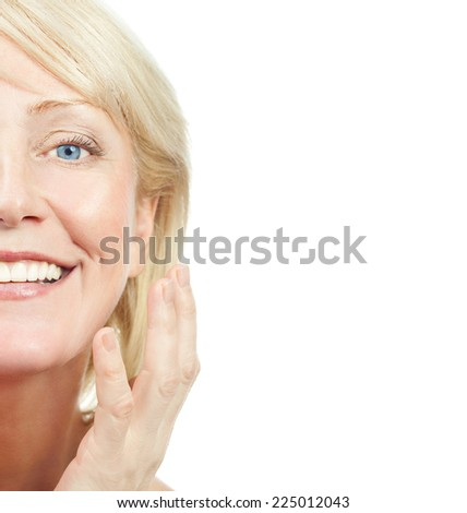 closeup portrait of attractive  caucasian smiling old mature woman brunette isolated on white studio shot lips toothy smile face hair head and shoulders looking at camera tooth riffles - stock photo