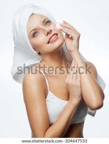 closeup portrait of attractive  caucasian smiling woman blond isolated on white studio shot lips toothy smile face hair head and shoulders blue eyes towel mirrow cleaning cotton disc - stock photo
