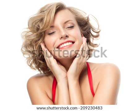 closeup portrait of attractive  caucasian smiling woman blond isolated on white studio shot lips toothy smile face hair head and shoulders looking at camera eyes closed - stock photo