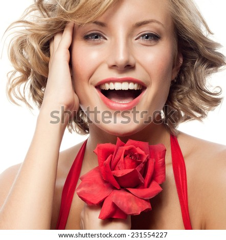 closeup portrait of attractive  caucasian smiling woman blond isolated on white studio shot lips toothy smile face hair head and shoulders looking at camera blue eyes tooth red rose flower - stock photo