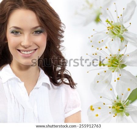 closeup portrait of attractive  caucasian smiling woman brunette isolated on white studio shot toothy smile looking at camera tooth spring flowers  - stock photo