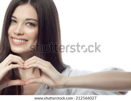 closeup portrait of attractive  caucasian smiling woman brunette isolated on white studio shot lips toothy smile face hair head and shoulders looking at camera tooth businesswoman heart - stock photo