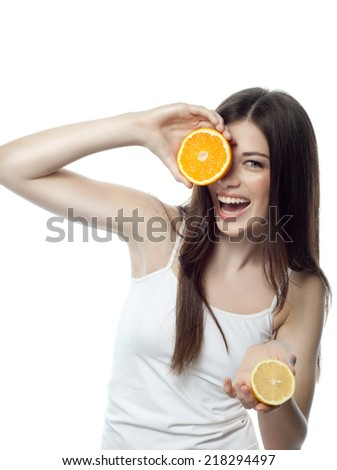 closeup portrait of attractive  caucasian smiling woman brunette isolated on white studio shot lips toothy smile face hair head and shoulders looking at camera tooth orange lemon - stock photo