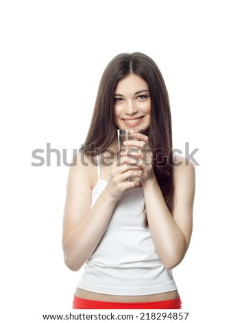 closeup portrait of attractive  caucasian smiling woman brunette isolated on white studio shot lips toothy smile face hair head and shoulders looking at camera tooth drinking water - stock photo