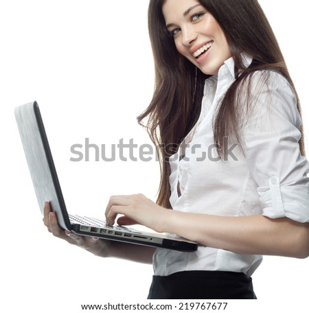 closeup portrait of attractive  caucasian smiling woman brunette isolated on white studio shot lips toothy smile face hair head and shoulders looking at notebook laptop businesswoman typing - stock photo