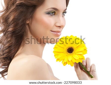 closeup portrait of attractive  caucasian smiling woman brunette isolated on white studio shot lips  smile face skin hair head and shoulders hand yellow flower aroma spring summer - stock photo