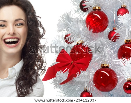 closeup portrait of attractive  caucasian smiling woman brunette isolated on white studio shot lips toothy smile face hair head and shoulders looking at camera tooth christmas tree new year - stock photo