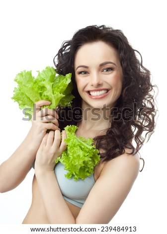 closeup portrait of attractive  caucasian smiling woman brunette isolated on white studio shot lips toothy smile face hair head and shoulders looking at camera tooth eating salat - stock photo