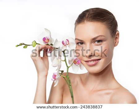 closeup portrait of attractive  caucasian smiling woman brunette isolated on white studio shot lips toothy smile face head and shoulders looking at camera tooth flower - stock photo