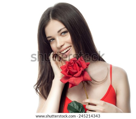 closeup portrait of attractive  caucasian smiling woman brunette isolated on white studio shot lips toothy smile face hair head and shoulders looking at camera tooth red rose flower  - stock photo