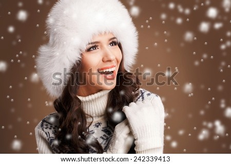 closeup portrait of attractive caucasian smiling woman brunette, studio shot toothy smile face hair head and shoulders looking at camera warm clothing winter christmas - stock photo