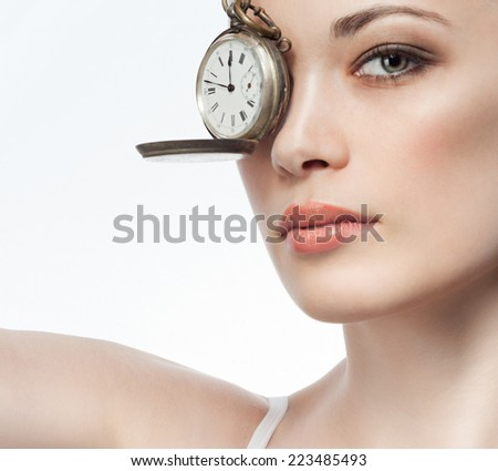 closeup portrait of attractive  caucasian  woman brunette isolated on white studio shot lips  face hair head and shoulders looking at camera watches time  - stock photo