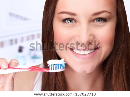Closeup portrait of attractive female clean teeth in the bathroom, dental clinic, dentistry health care, healthy lifestyle, tooth whitening concept - stock photo
