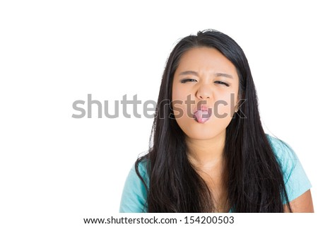 Closeup portrait of attractive female sticking tongue out  isolated on white background with copy space - stock photo